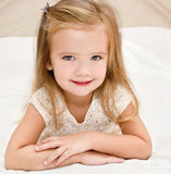 Little girl resting on the bed Royalty Free Stock Photo
