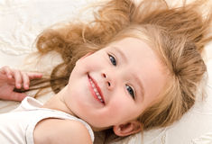 Little girl resting in the bed Royalty Free Stock Photography
