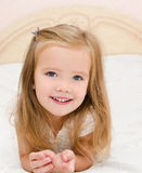 Little girl resting on the bed Stock Photos