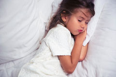 Little girl resting in bed Stock Photo