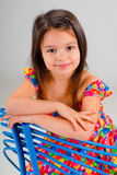 Little girl resting on a chair Stock Image