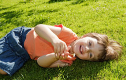 Little girl resting in the garden Royalty Free Stock Photography