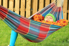 Little girl resting in hammock Stock Photo