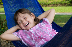 Little girl resting in hammock Royalty Free Stock Photo