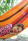 Little girl resting in the hammock in the resort Royalty Free Stock Images