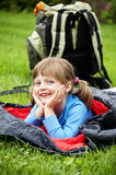 Little Girl Resting In A Sleaping Bag Royalty Free Stock Photo