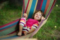 Little girl resting lying on hammock Stock Photography
