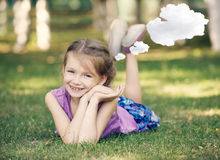 Little girl resting on meadow Royalty Free Stock Image