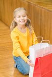 Little girl resting after shopping Stock Photo