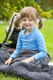 Little girl resting in a sleaping bag Stock Images