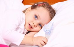 Little girl resting after treatment with aerosol. Portrait of a little girl resting after treatment with aerosol royalty free stock images