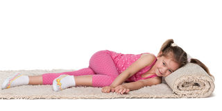 Little girl rests on the carpet Stock Images