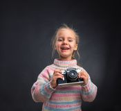 Little girl with retro camera Stock Photo