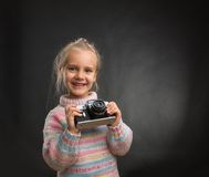 Little girl with retro camera Stock Image
