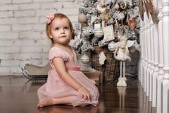 Little girl in retro Christmas interior Stock Image