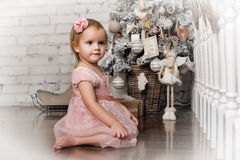 Little girl in retro Christmas interior Royalty Free Stock Photography