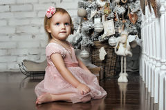 Little girl in retro Christmas interior Royalty Free Stock Image