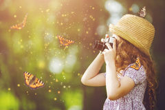 Little girl with retro photo camera. Royalty Free Stock Photo