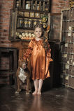 Little girl in retro style with stylish hairstyle and dog Royalty Free Stock Images