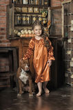 Little girl in retro style with stylish hairstyle and dog Royalty Free Stock Photography