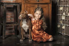 Little girl in retro style with stylish hairstyle and dog Stock Photos