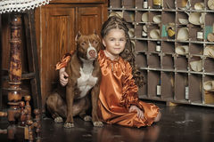 Little girl in retro style with stylish hairstyle and dog Royalty Free Stock Photos