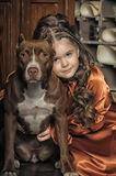 Little girl in retro style with stylish hairstyle and dog Stock Photo
