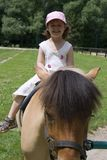 Little girl by ride Stock Photo