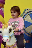 Little girl ride on carousel horse Royalty Free Stock Image