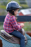 Little girl ride a horse during horse ridding lesson Stock Photo
