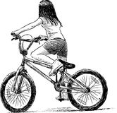 Little girl rides a bicycle Royalty Free Stock Photography