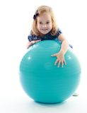 Little girl rides a big sports ball Stock Photography