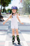 Little girl rides on roller skates at park Royalty Free Stock Photography