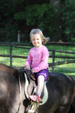 Little girl riding Stock Image