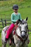 Little girl riding stock photo