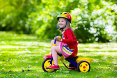 Free Little Girl Riding A Tricycle Royalty Free Stock Image - 73345006