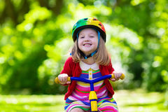 Little Girl Riding A Tricycle Stock Photography