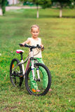 Little girl riding a  bicycle Stock Photos
