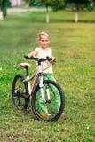 Little girl riding a  bicycle Stock Photos