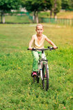 Little girl riding a  bicycle Stock Photo