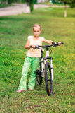 Little girl riding a  bicycle Royalty Free Stock Image