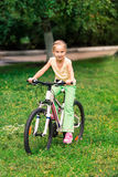 Little girl riding a  bicycle Stock Image