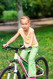 Little girl riding a  bicycle Royalty Free Stock Photos