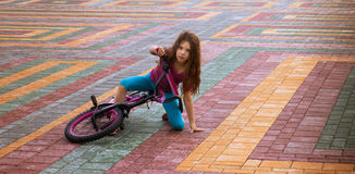 Little girl riding bicycle Stock Images