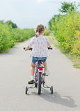 Little girl riding a bicycle. Stock Photography