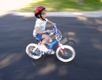 Little Girl Riding a Bike Stock Photo