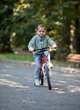 Little girl riding bike Stock Photography