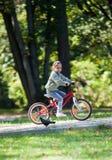 Little girl riding bike Royalty Free Stock Photo