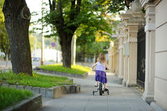 Little girl riding a bike Royalty Free Stock Images
