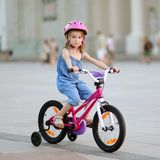 Little girl riding a bike Royalty Free Stock Photo